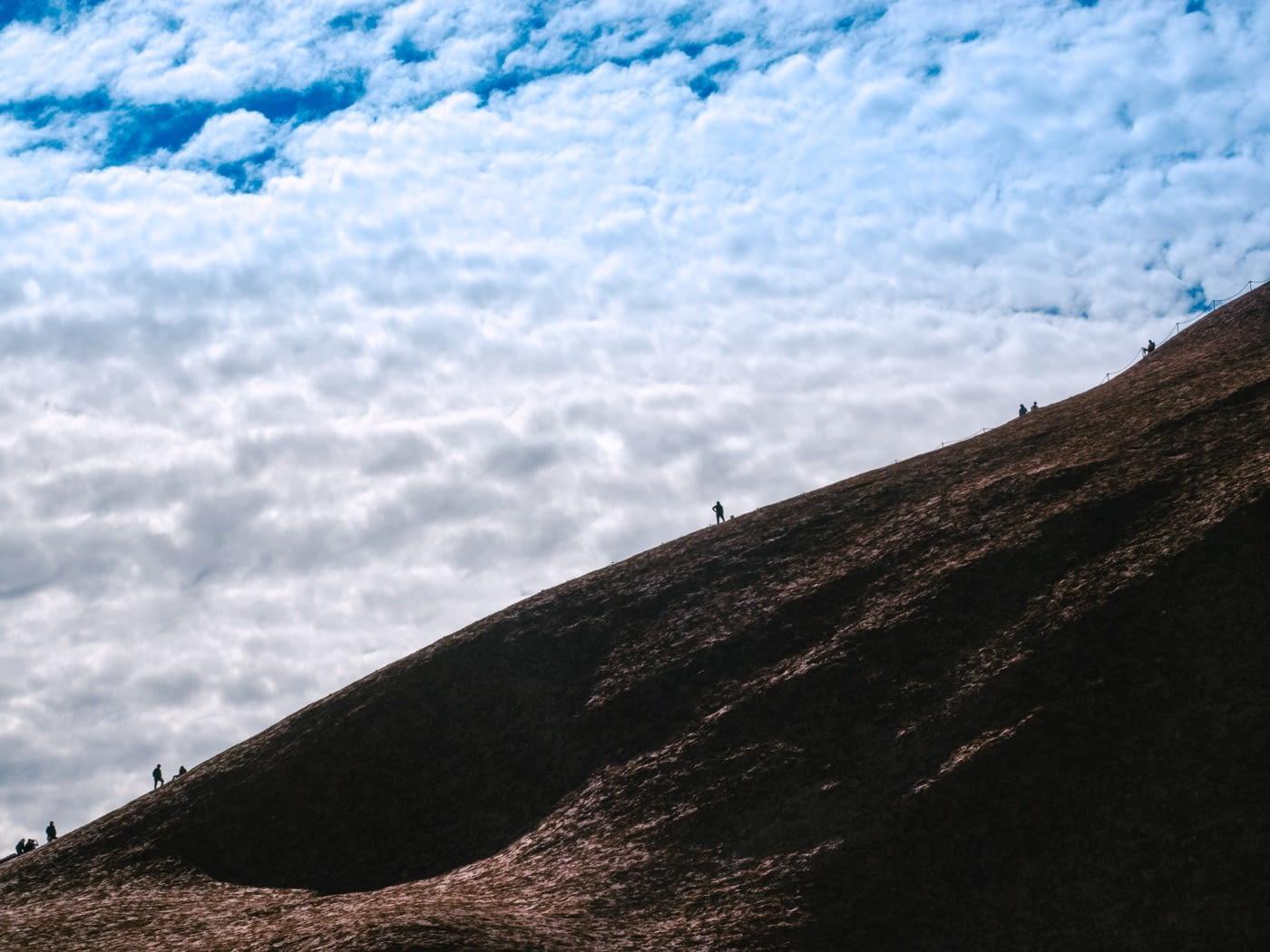 NT Australia - Tourist climbing Uluru
