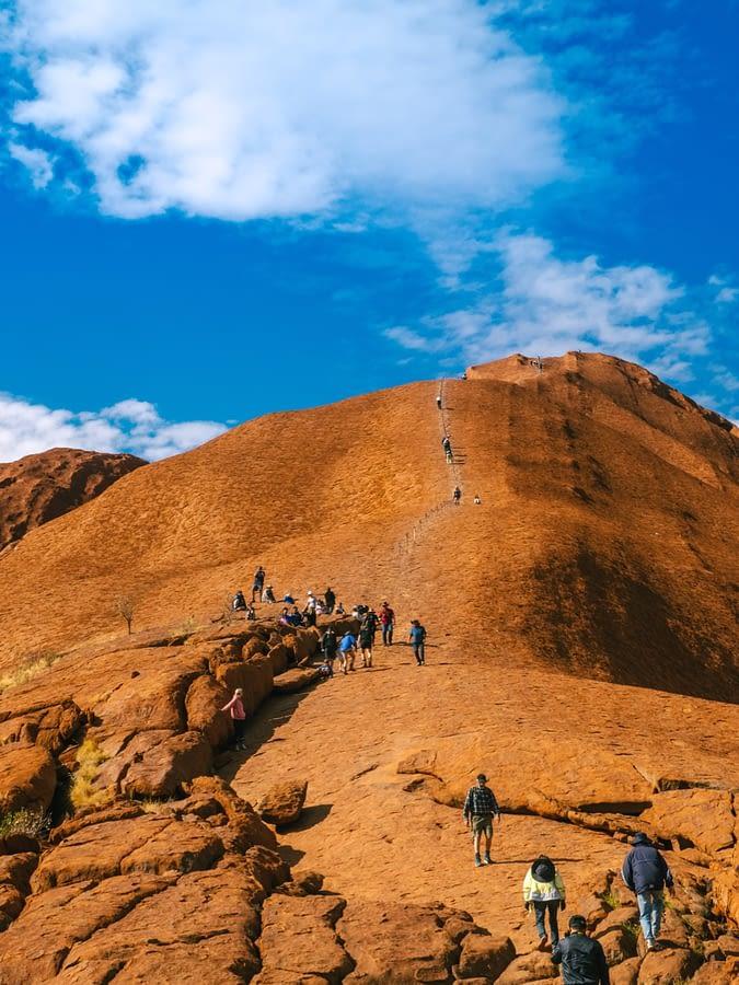 NT Australia - Tourist climbing Uluru from a different angle