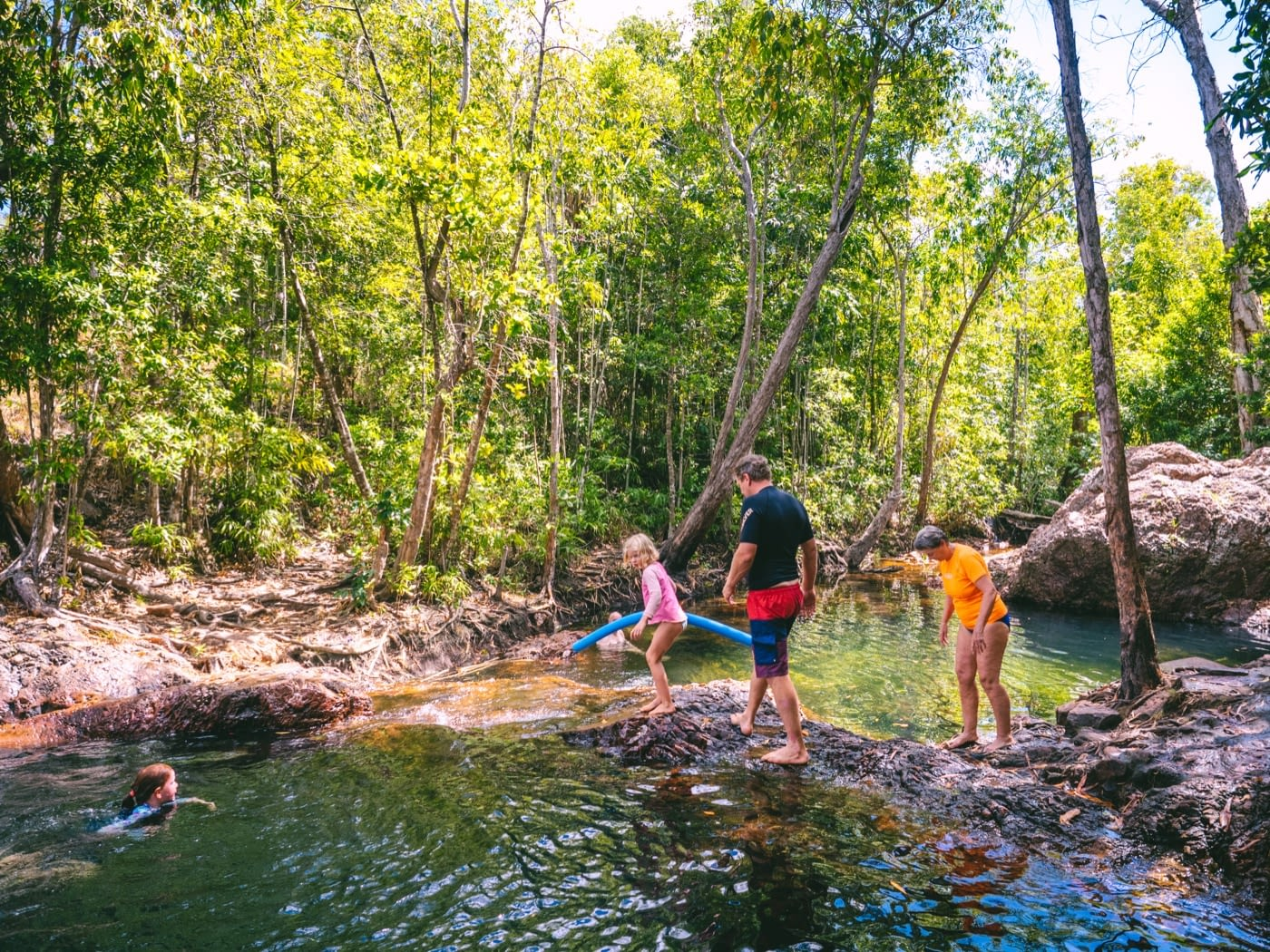 Kids lining up to get into the water at Buley Rockhole