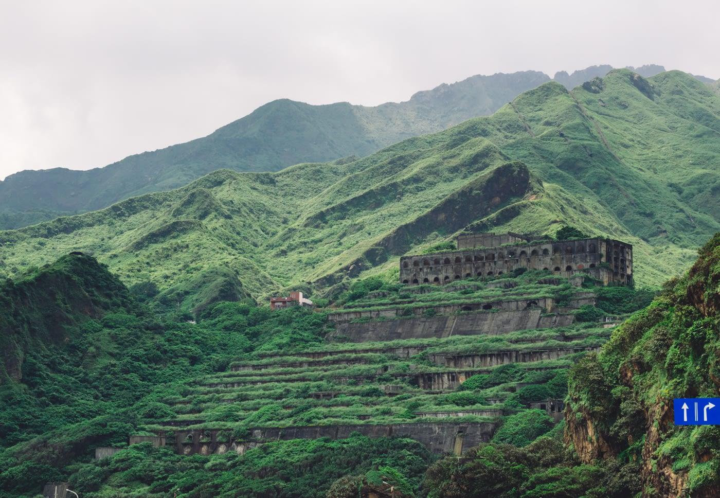 Taiwan - New Taipei City - Abandoned building amidst greenery mountain