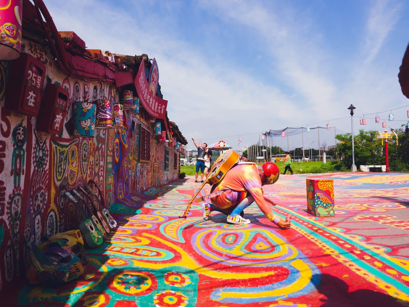 Taiwan - Rainbow Village - Iron man taking perspective selfies