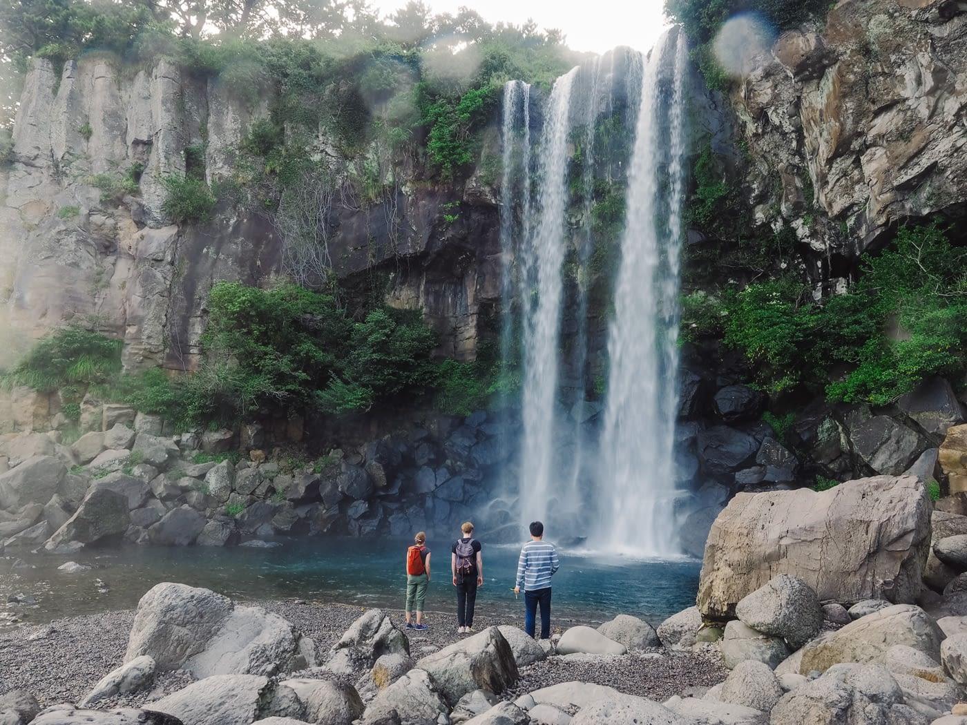 Korea - Mt Hallasan - Foreigner tourist enjoying the Jeongbang fall
