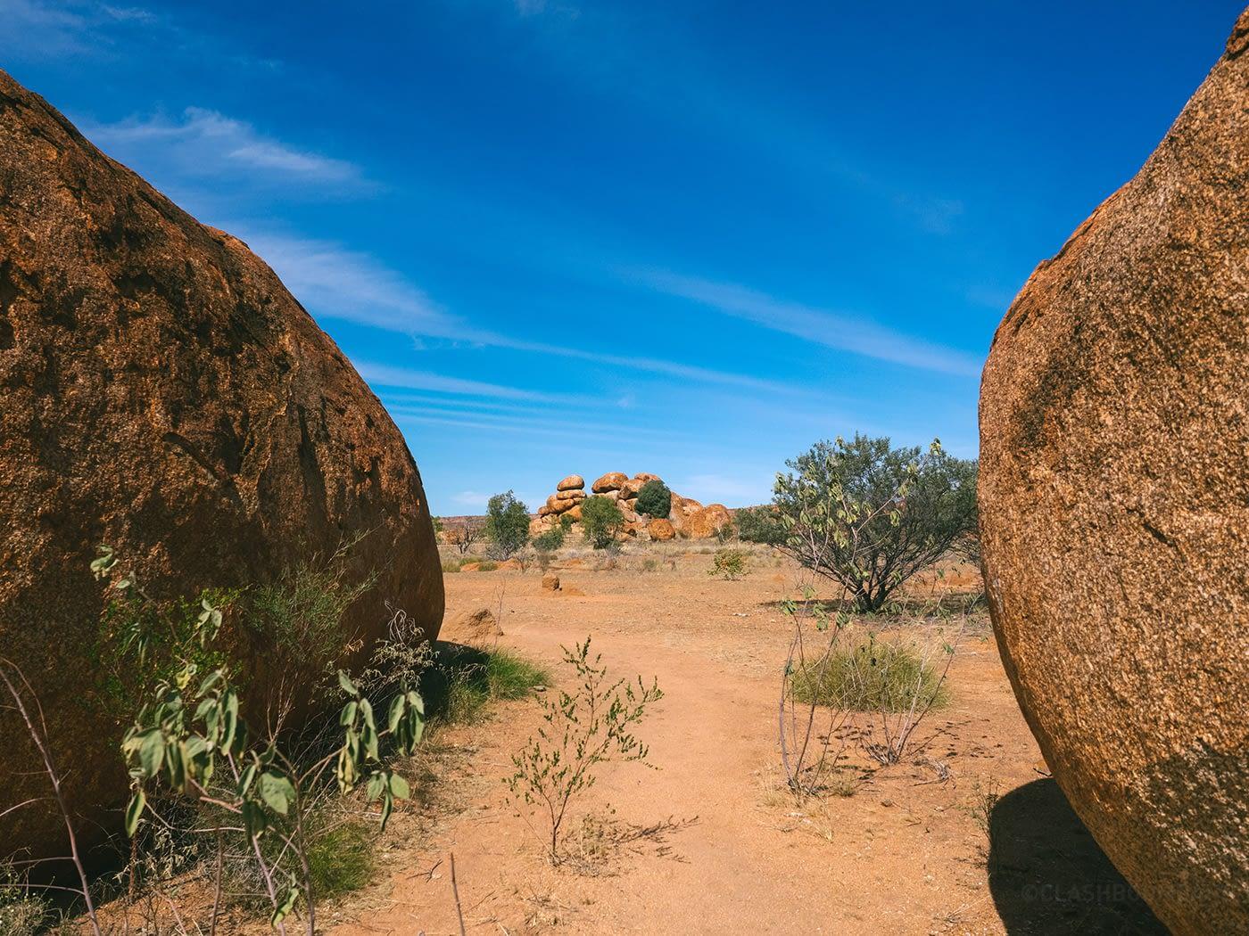 NT Australia - Karlu Karlu - Stack of boulders peeping through 2 huge boulders